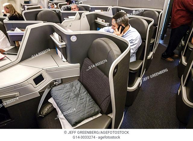 Argentina, Buenos Aires, Ministro Pistarini International Airport Ezeiza EZE, onboard cabin, interior, American Airlines business class section seating seats