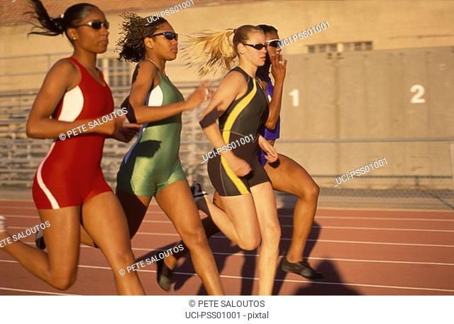 Multi-ethnic female athletes running