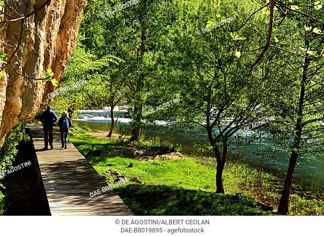 Two hikers on a walkway near Roski Slap, Krka Waterfalls, Krka National Park, Croatia