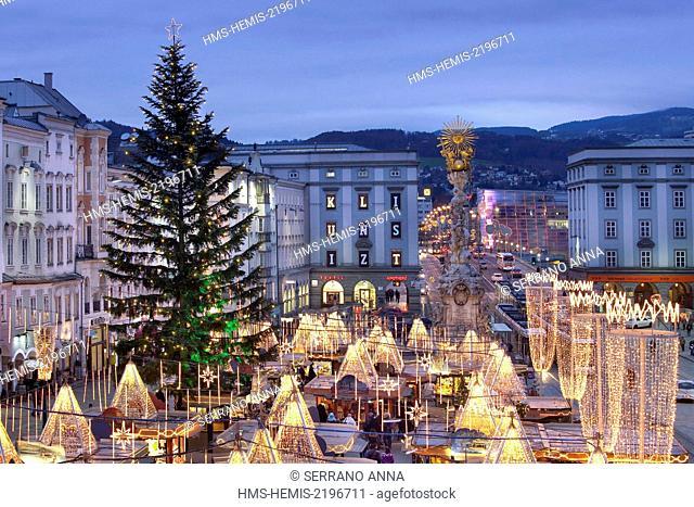 Austria, Upper Austria, Linz, Hauptplatz Christmas Market at dusk