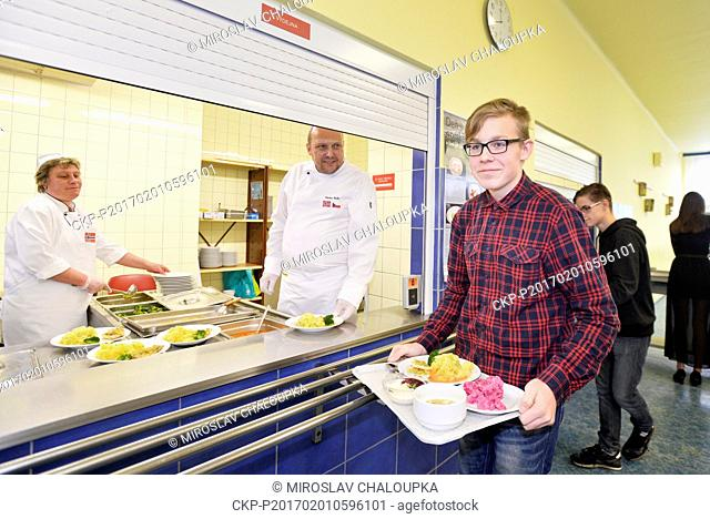 Chef Vaclav Hokr, centre, serves the Norwegian cuisine for lunch in the school canteen in the 15th elementary school in Pilsen, Czech Republic, Wednesday