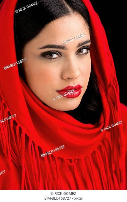 Glamorous Hispanic woman wearing headscarf