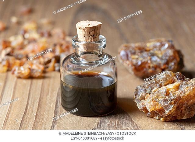 A bottle of essential oil with myrrh resin