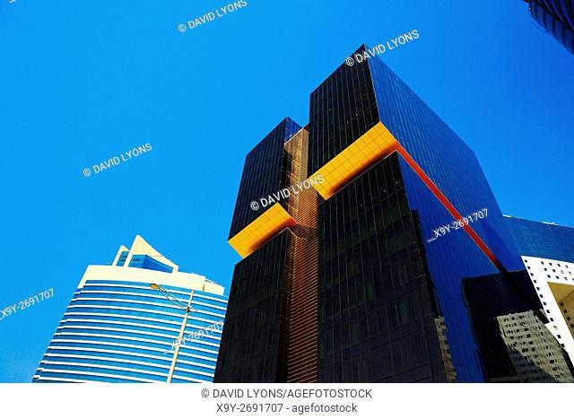 City centre Doha, Qatar. Towers line Majlis Al Taawon Street. Left Qatar Petroleum District Tower. Right Golden Bay Tower