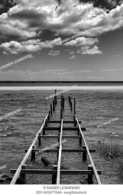 Old broken pier at the lagoon of Bacalar, Quintana Roo, Mexico