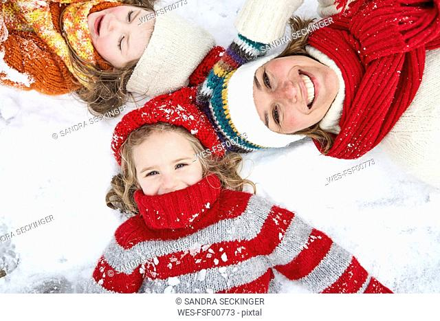 Mother and daughters having fun in winter