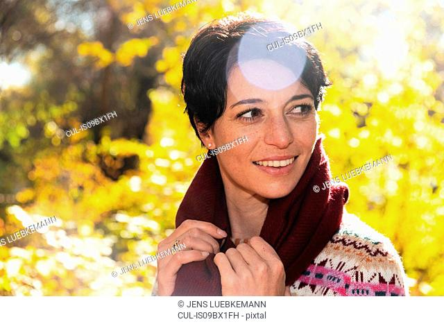 Smiling woman in autumnal forest