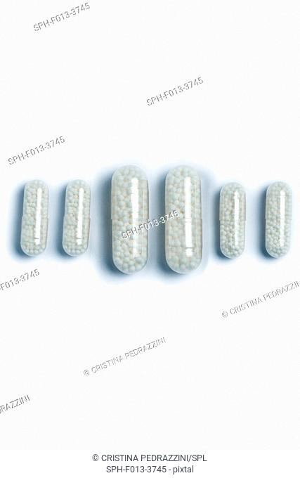 White capsules against a white background