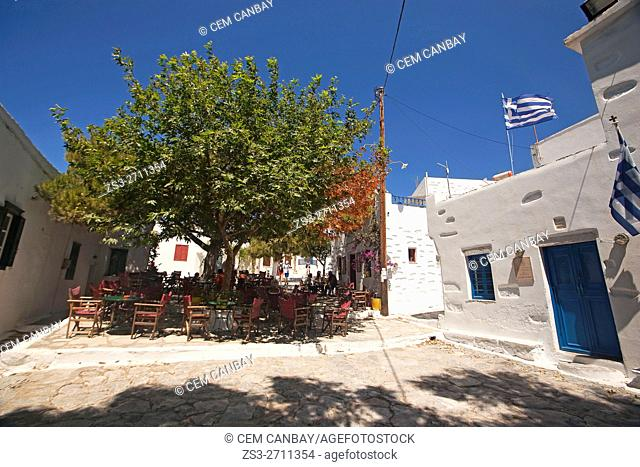People sitting in an open-air cafe at the old town Chora, Amorgos, Cyclades Islands, Greek Islands, Greece, Europe