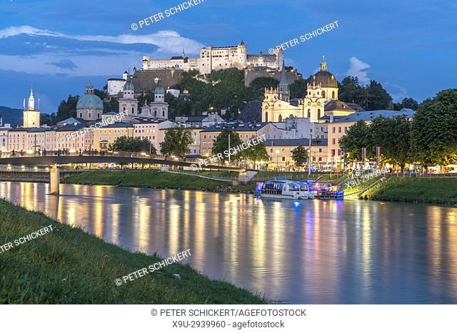cityscape with river Salzach, Cathedral and Salzburg fortress at dusk, Salzburg, Austria