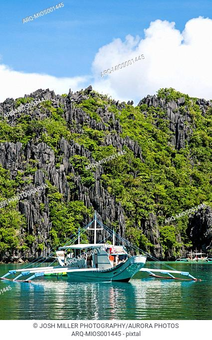 Boat Touring The Tropical Islands Of El Nido In The Philippines