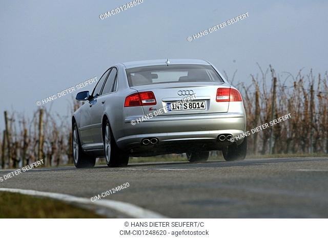 Audi S8, model year 2005-, silver, driving, diagonal from the back, rear view, country road