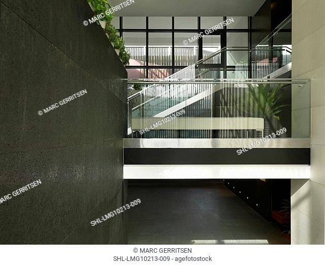Glass railing along staircase landing