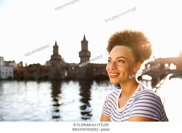 Young woman at Spree river, portrait