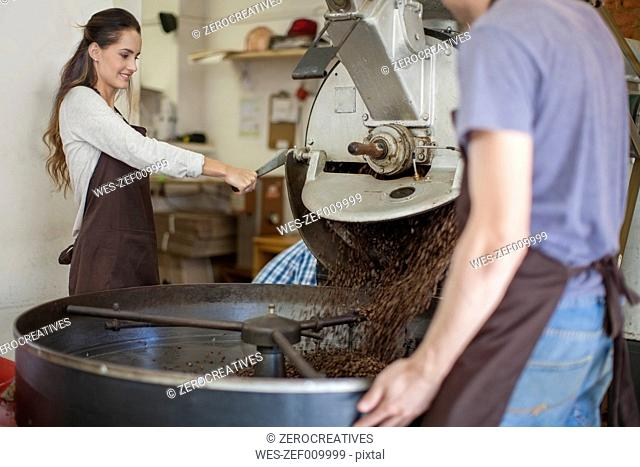Colleagues at coffee roasting machine