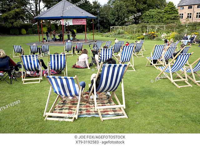 empty deckchairs on the grass in a park at an outdoor summer event in the uk