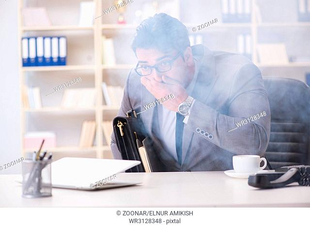 The businessman during fire alarm in office