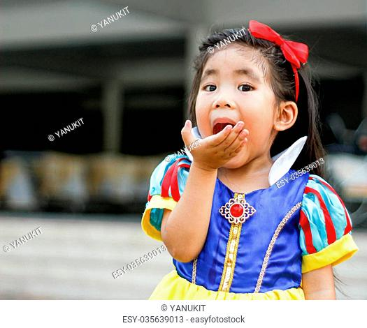 potrait princess dress with cute asian girl eat apple