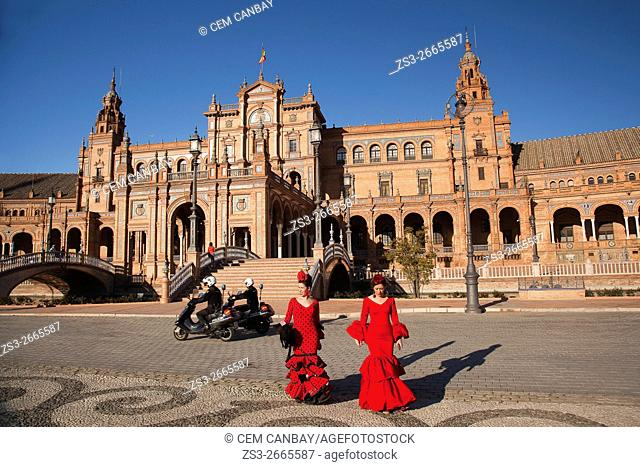 People in traditional clothing during the April Fair celebrations in Plaza de Espana, Seville, Andalusia, Spain, Europe