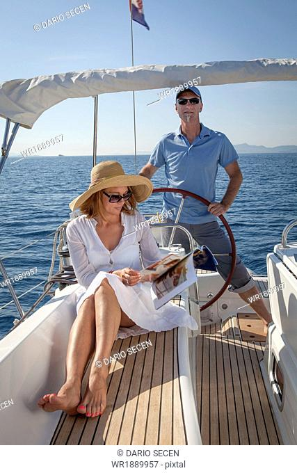 Mature couple on sailboat, using digital tablet, Adriatic Sea, Croatia