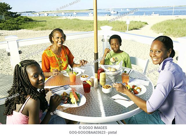 Young African couples eating together