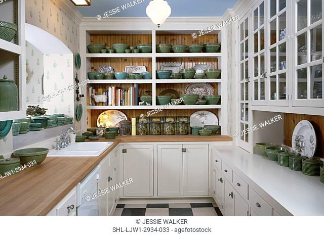 Kitchen: Scullery room connected to kichen by open arch over sinks, glass fronted cabinets, green pottery collection, wood counter tops