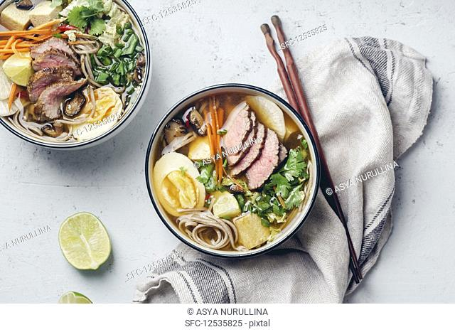 Asian Miso ramen with roasted beef, shiitake mushrooms, fried tofu, leek and eggs