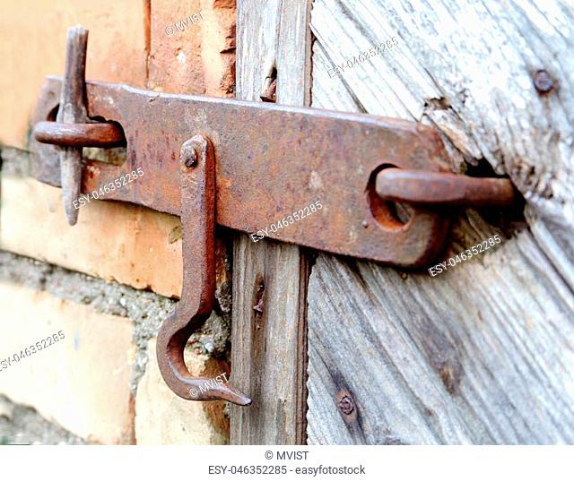 lock on the door of an old farmhouse . true village style