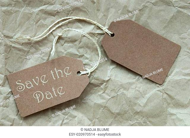 Two Beige Labels With Text Save The Date Paper Background