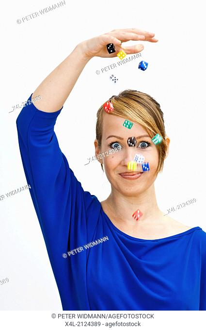 woman with dices in the air (model-released)