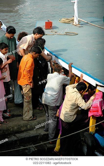 Mumbai, India: people taking a boat in Colaba