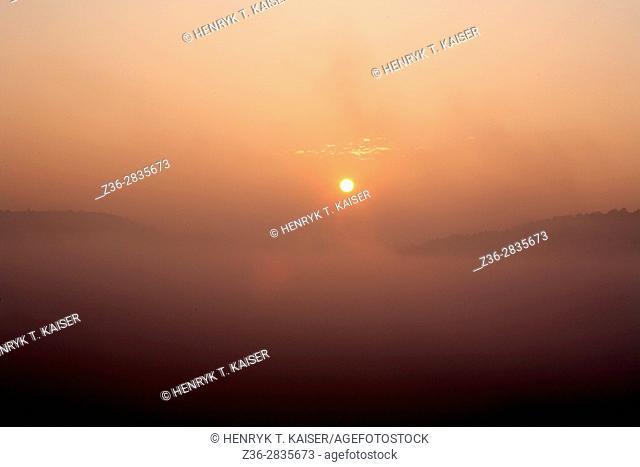 Sunrise at foggy morning