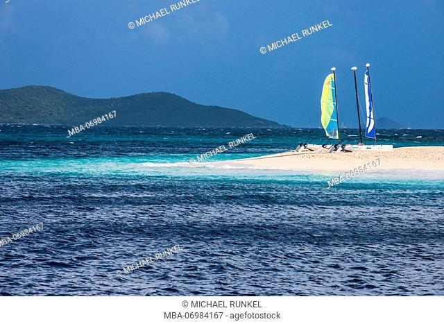 Catamarans on a beautiful white sand beach on Palm island, Grenadines islands, St. Vincent and the Grenadines, Caribbean