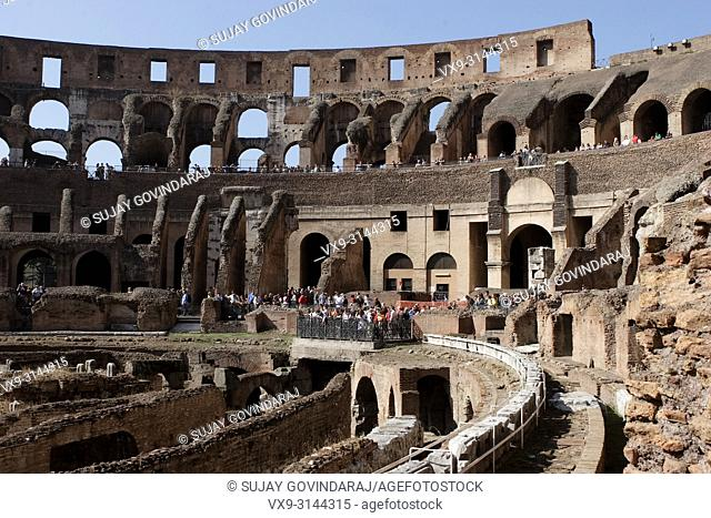 Rome, Italy - October 13, 2017: Tourists from around the world visiting one of ancient wonders, the famous Colosseum of Rome in Italy