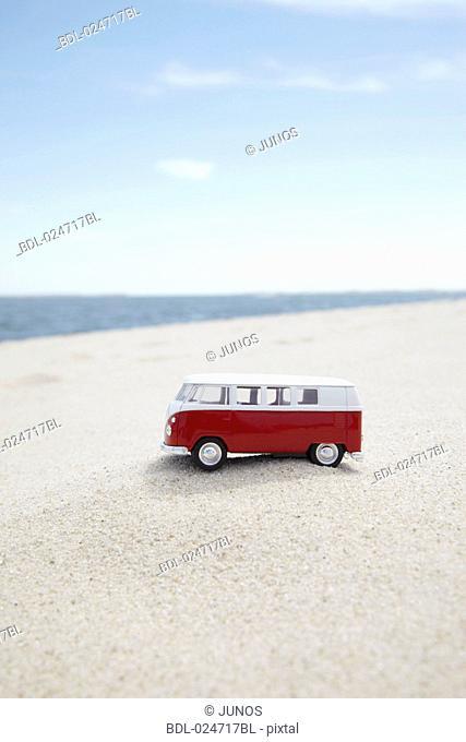vw toy car on sandy beach