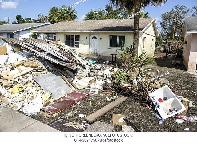 Florida, Bonita Springs, after Hurricane Irma storm water damage destruction aftermath, , flooding, house home, front yward, debris trash pile