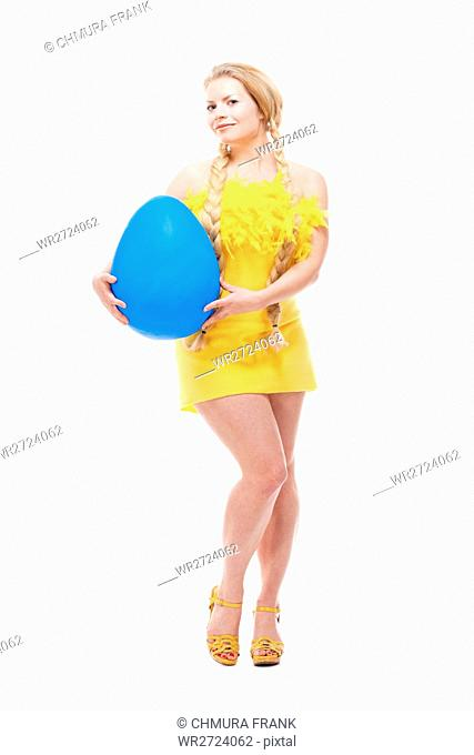Easter - Young Woman with Long Blond Hair, Yellow Dress and Large Blue Egg