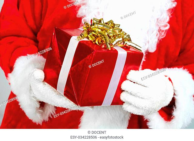 Hands of Christmas Santa Claus with gift