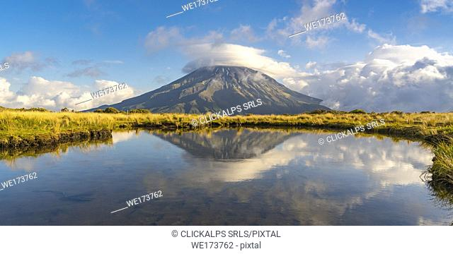 Reflection of Mount Taranaki. Egmont National Park, New Plymouth district, Taranaki region, North Island, New Zealand