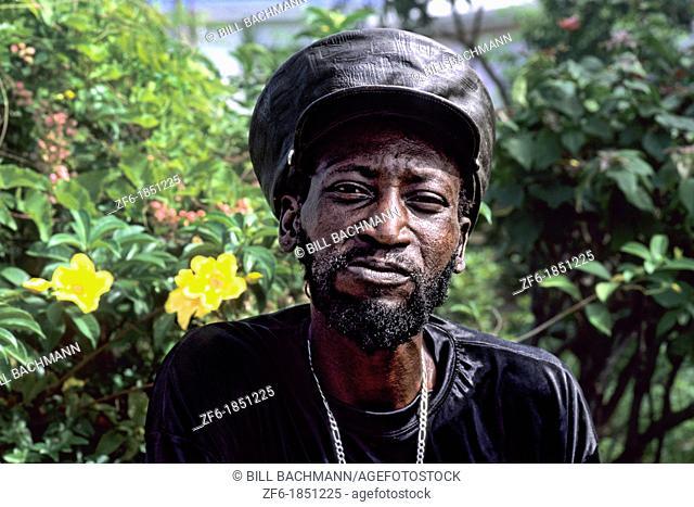 Reggae native man with hat in colorful gardens near St John Antigua