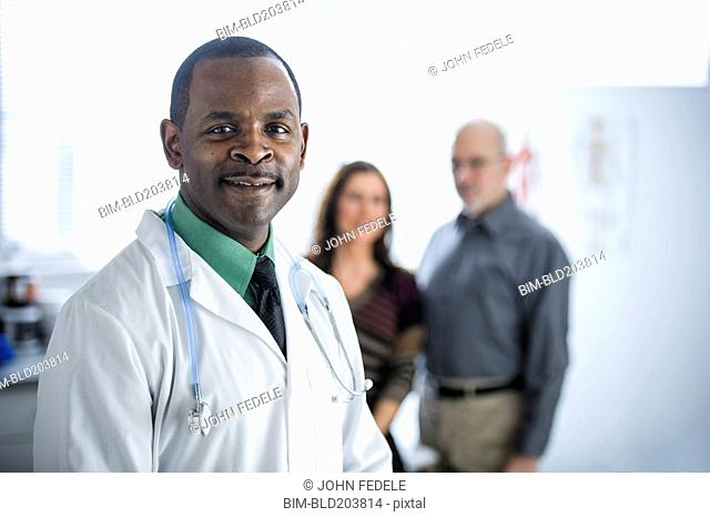 Doctor and patients standing in office