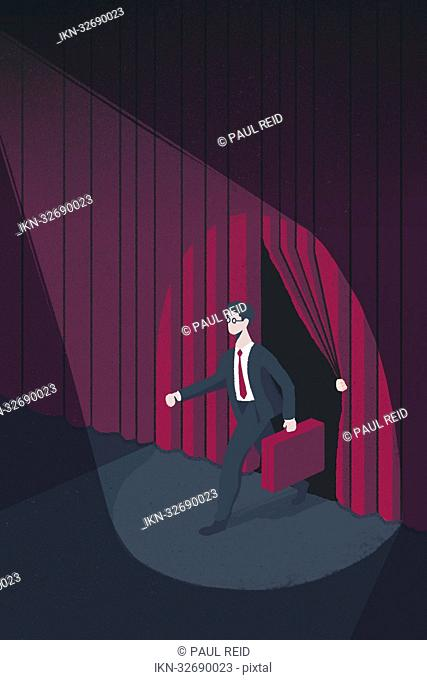 Spotlight on businessman on stage