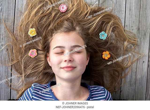Crochet flowers on girls hair