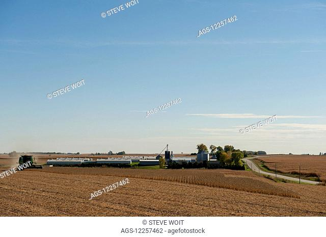 Harvesting on a farm in autumn; United States of America