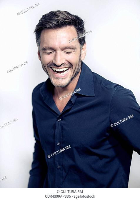 Portrait of mature man laughing