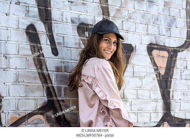 Portrait of a beautiful young woman wearing a baseball cap