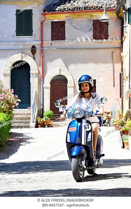 Woman on Vespa scooter, Piazza Tarsetti, Morro D'Alba, Marche, Italy