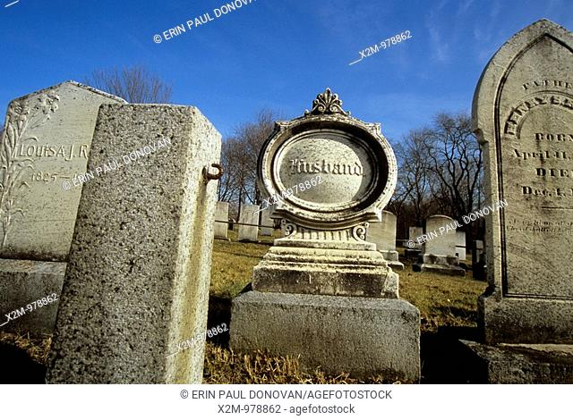 Old weathered headstones at South Cemetery in Portsmouth, New Hampshire,USA, which is in an scenic New England graveyard