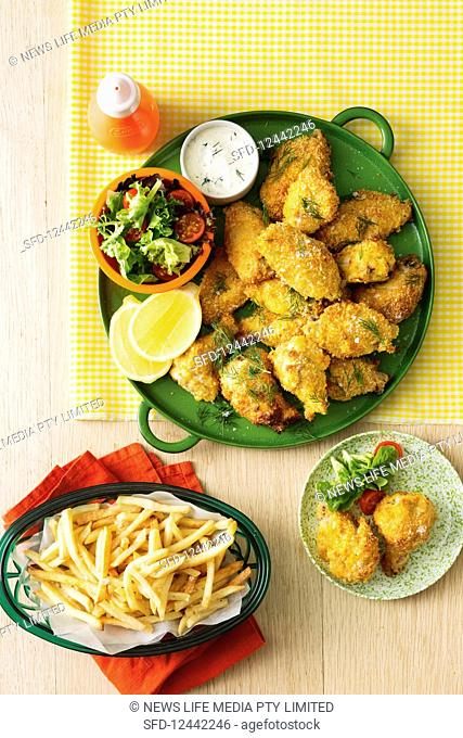 Breaded chicken wings served with french fries