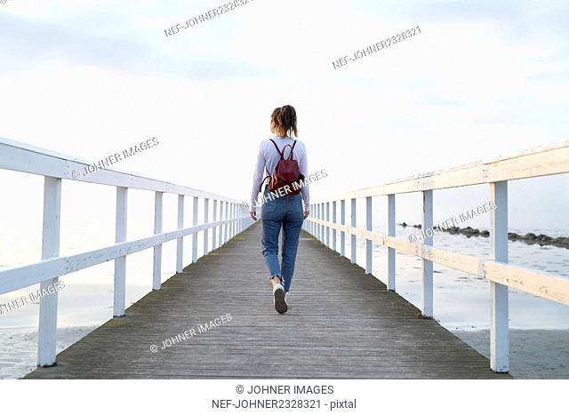 Woman walking on jetty